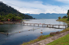 Bridge with fishermen on Lake Maninjau Royalty Free Stock Photo