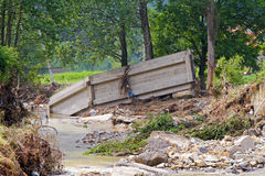 Bridge after flooding. Old bridge distroyed in natural disaster flooding stock images