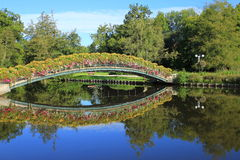 Bridge of flowers. Beautiful bridge of flowers,with reflection in lake,taken in Normandy,France Royalty Free Stock Images