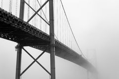 Bridge in fog Stock Images