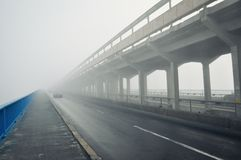 Bridge in a fog. Bridge in a deep fog over river Dnieper (Dnipro) in Kiev, Ukraine Stock Images