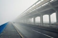 Bridge in a fog Stock Images