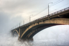 Bridge in the fog Stock Photography
