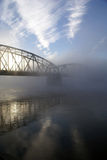 Bridge in fog. Bridge over river on a foggy morning stock photography