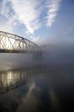 Bridge in fog. Bridge over river on a foggy morning Stock Photography