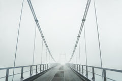 Bridge in the fog. Royalty Free Stock Images