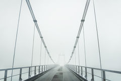 Bridge in the fog. Royalty Free Stock Photography