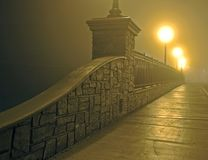 Bridge in Fog at Night. Night photo of a deserted bridge in dense fog.  A perfect movie set for Bogey and Bacall Stock Photos