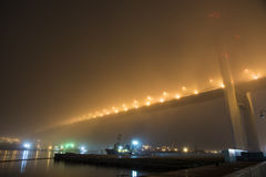 Bridge in the fog, over the Bay. Royalty Free Stock Photos