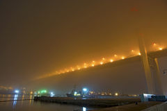 Bridge in the fog, over the Bay. Royalty Free Stock Photography