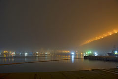 Bridge in the fog, over the Bay. Royalty Free Stock Image