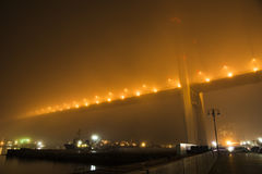 Bridge in the fog, over the Bay. Stock Images