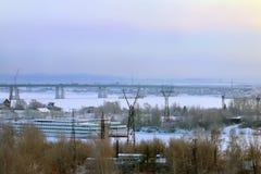 Bridge in fog over frozen river and passenger ships Stock Photo