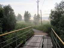 Bridge and fog. Road through the old bridge in the fog Stock Photo