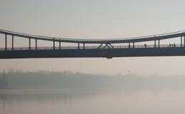 Bridge in fog. Walking bridge above Dnipro river in Kiev in morning fog Stock Image