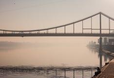 Bridge in fog. Walking bridge above Dnipro river in Kiev in morning fog Stock Photography