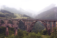 Bridge in foggy mountains Royalty Free Stock Images