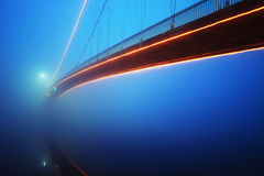 Bridge on a foggy night. Lit bridge on a foggy night Royalty Free Stock Image