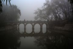 Bridge. The bridge of the foggy Park Stock Photos