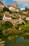 Bridge and fortified walls. Bridge and defence walls reflecting in water in a beautiful medieval French town Royalty Free Stock Photos