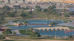 Bridge with fountain and lake in the Aspire park timelapse in Doha, Qatar. Aerial top view early morning during sunrise stock footage