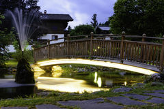 Bridge and fountain. Bridge to mini-golf in Hinterglemm Stock Image