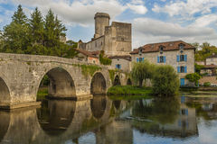 Bridge in front of medieval castle. The Château de Bourdeilles is a castle located in the commune of Bourdeilles in the Dordogne département in France Royalty Free Stock Images