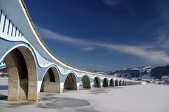 Bridge on frozen lake Royalty Free Stock Photo