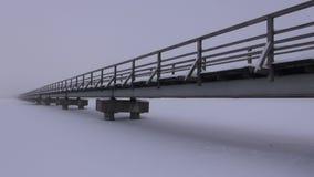 Bridge through frozen lake stock video footage