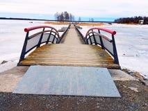 Bridge on the frozen sea Stock Images