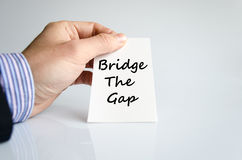 Bridge the gap text concept. Isolated over white background royalty free stock photography