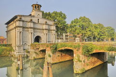 Bridge and Gate. Old bridge and city gate (1518) on the Brenta river, called Portello, in Padua, Veneto, Italy Stock Images