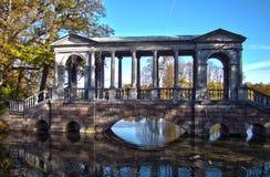 Bridge with gazebo. On the pond in the garden in Pushkin Stock Photo