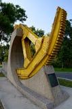 Bridge Gear Monument, Winnipeg, Manitoba, Canada. Yellow Bridge Gear Monument, Winnipeg, Manitoba, Canada royalty free stock image