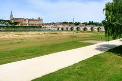 Bridge and Gien city in Loire river in summer. Travel to France - bridge and Gien city in Loire river in summer day Stock Images