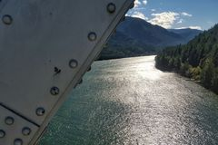 Bridge of the gods and the columbia river. Metal piece of the bridge of the gods with the columbia river in the background stock image