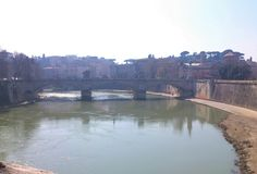The Bridge and Green River in Rome, Italy Royalty Free Stock Image