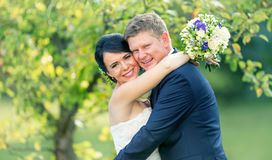 Bridge and groom. Happy wedding pair after wedding ceremony in g Royalty Free Stock Photos
