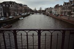 Bridge in Haarlem City Dark Red Water Canal Cars Old Houses royalty free stock photos