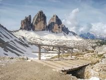 Bridge with handrail at popular trek around Tre Cime di Lavaredo. Wooden bridge and wooden handrail at difficulty part of popular trek around Tre Cime di royalty free stock photos
