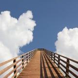 Bridge into heaven. Sky with dreamy clouds Stock Photos