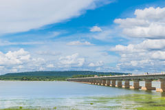The bridge of  Her Majesty Thepsuda,Lam Pao Dam,Kalasin province,Thailand with the beautiful blue sky and cloud. The bridge of Her Majesty Thepsuda,Lam Pao Dam Stock Images