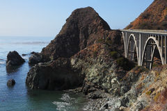 The bridge on highway of  Pacific coast. The magnificent bridge on coastal highway of rocky and steep Pacific coast USA Royalty Free Stock Photo