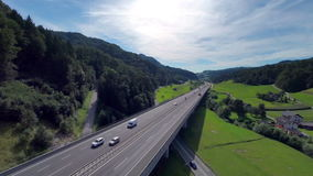 Bridge of a highway in a valley. Aerial shoot of a bridge of a highway in a nature valley full of cars and trucks traffic stock video footage