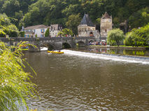 Bridge and historical buildings, Brantome, Dordogne, France Stock Photos