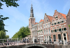 Bridge in Holland. Old bridge, church and historic houses in Leiden, Holland Stock Photo