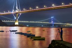 Bridge in Hong Kong. Photographer taking photo of Ting Kau Bridge and Tsing Ma Bridge in Hong Kong at night royalty free stock photo