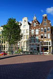 Bridge and houses in Amsterdam Stock Photos
