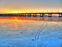 The bridge in ice and winter river Stock Photos