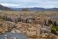 A bridge in Icelandic mountains Royalty Free Stock Photography